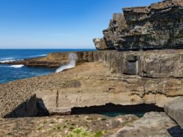 Cliffs and worm hole in Inishmore, Aran Islands, Ireland